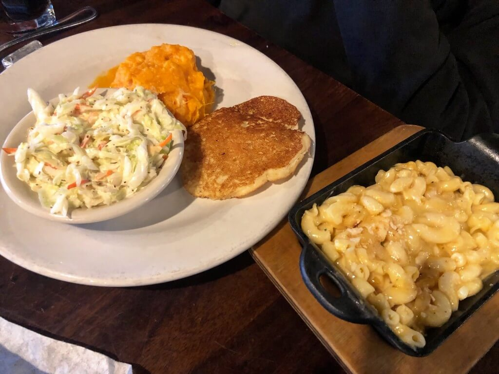 Veggie plate with macaroni and cheese, smashed sweet potatoes, and coleslaw